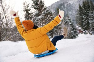 Woman sledding outdoors