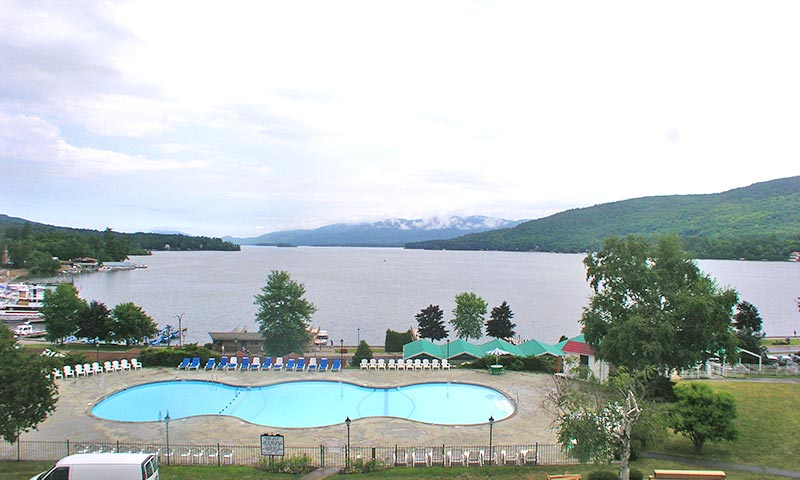 looking out over a pool onto lake george